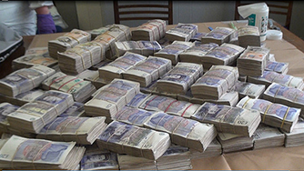 Stacks of cash laid out