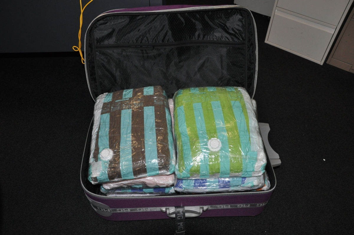 Wang's suitcase, containing the sealed packages