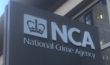 The NCA logo appearing on a sign