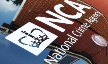 National Crime Agency logo appearing on the front of a black car.