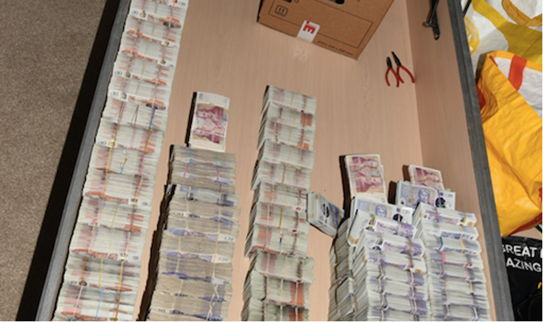 piles of cash hidden inside double bed